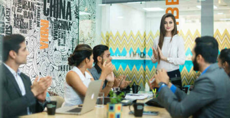Men and women having a meeting.