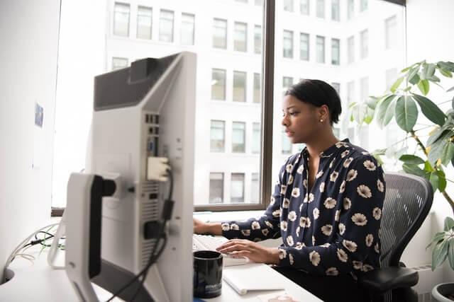 Woman using a desktop computer.