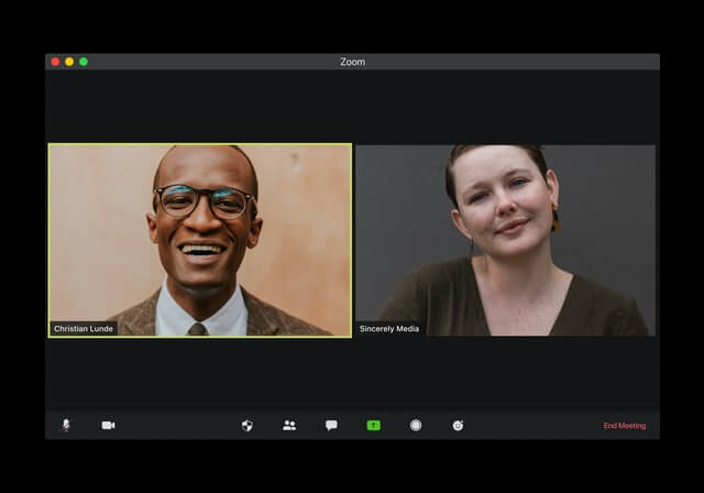A man and woman have a video chat.