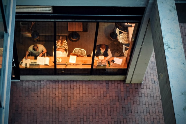 People work in a cafe in the late afternoon.