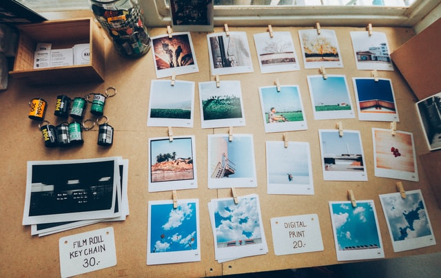 Developed film and photos arranged on a desk.